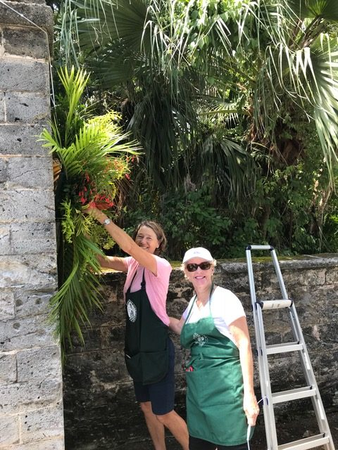 Jan MacDonald & Karen Smith working on a flower display at Government House in Bermuda for the Queen's birthday